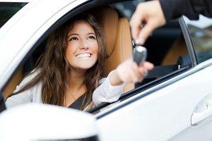 woman receiving keys of her new car from dealer 72513573 1600x1600 2 8239281